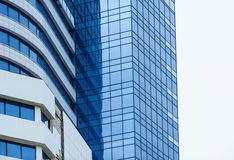 Glass high-rise office building on a background of the sky Royalty Free Stock Photo