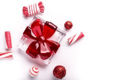 Glass Holiday gift with candy ornaments. On a white background royalty free stock image