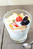 Glass of home made yogurt with cereals, strawberry, ban Royalty Free Stock Images