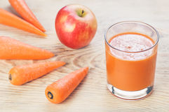 Glass of homemade juice, apple and carrot on Royalty Free Stock Photo