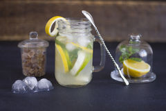 A glass of homemade lemonade on a dark background Royalty Free Stock Photography