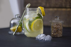 A glass of homemade lemonade on a dark background Royalty Free Stock Image