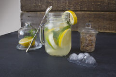 A glass of homemade lemonade on a dark background Royalty Free Stock Images