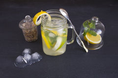 A glass of homemade lemonade on a dark background Stock Photography