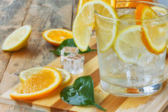 Glass homemade lemonade, ice, orange, lemon closeup Royalty Free Stock Image