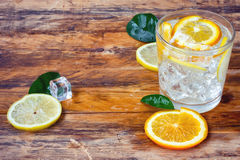 Glass homemade lemonade, lemon, orange Stock Image