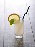Glass of homemade lemonade with slice of lemon and leaf of mint Royalty Free Stock Image