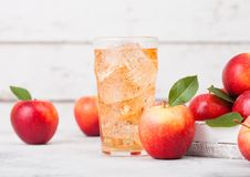 Glass of homemade organic apple cider with fresh apples in box on wooden background. Space for text Royalty Free Stock Photos