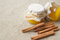 A glass of honey with cinnamon Royalty Free Stock Images