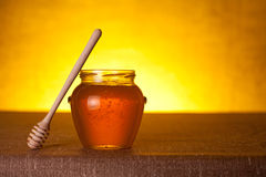 Glass honey jar with dipper Royalty Free Stock Photo