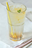 Glass of honey lime soda drink Stock Images