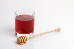 Glass and honey stick (with cliping path) Royalty Free Stock Photography