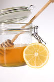 Glass honey with sticks Royalty Free Stock Images
