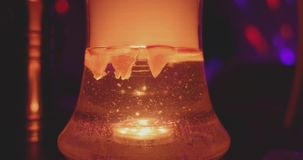 Glass hookah flask with backlight and orange slices inside in action.  stock video footage