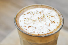 Glass of hot cappuccino Royalty Free Stock Images