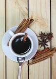Glass of hot cinamon espresso with Royalty Free Stock Photography