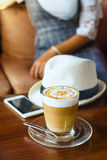 Glass of hot coffee on wood table Stock Photo