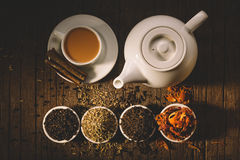 Glass of hot indian yoga drink - masala chai tea with spices and Royalty Free Stock Photos