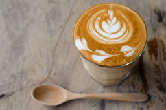 A glass of hot latte art coffee Stock Image
