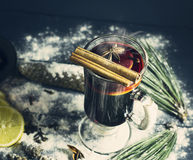 Glass hot Mulled wine with sticks of cinnamon, anise, lemon Royalty Free Stock Photo