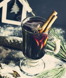 Glass hot Mulled wine with sticks of cinnamon, anise, lemon Stock Images