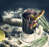 Glass hot Mulled wine with sticks of cinnamon, anise, lemon Royalty Free Stock Photos