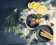 Glass hot Mulled wine with sticks of cinnamon, anise, lemon Royalty Free Stock Images