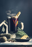 Glass hot Mulled wine with sticks of cinnamon, anise, lemon Stock Photography