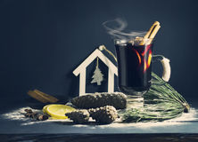 Glass hot Mulled wine with sticks of cinnamon, anise, lemon Stock Photos