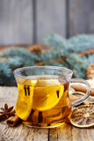 Glass of hot steaming tea among christmas decorations Royalty Free Stock Images