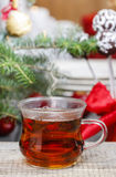 Glass of hot steaming tea Royalty Free Stock Photo
