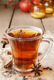 Glass of hot steaming tea among christmas decorations Royalty Free Stock Photos