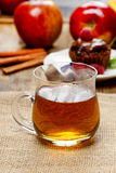 Glass of hot steaming tea on hessian napkin Royalty Free Stock Image