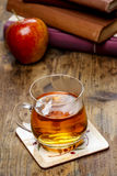 Glass of hot steaming tea on wooden tabl Stock Photography