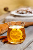 Glass of hot tea on rustic wooden table Stock Images