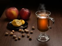 A glass of hot tea with steam.  stock image