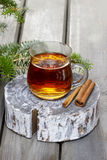 Glass of hot tea on wooden background Royalty Free Stock Photos