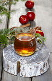 Glass of hot tea on wooden background. Royalty Free Stock Images