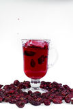 A glass of hot Uzvara of rose hips and berries scattered around. Effective methods to combat colds and flu. Royalty Free Stock Photos