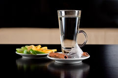 Glass of hot water with tea bag cinnamon and lemon Royalty Free Stock Photos