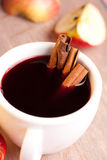 Glass of hot wine with cinnamon sticks Royalty Free Stock Image