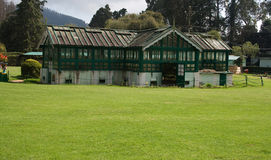 Glass House. A grass  surrounded  building covered with glass for preserving plants and cut flowers in Botanical garden. It is always open to public and tourists Stock Images
