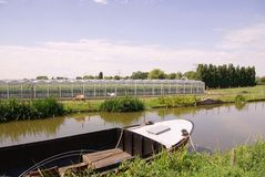Glass house with a canal in front Royalty Free Stock Photography