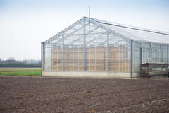 Glass house in landscape Royalty Free Stock Image