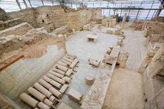Glass house under Ephesus city complex with ruined terraces from Roman period Royalty Free Stock Photos