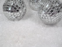 Glass and Ice. Mirrored ball ornaments on snow Stock Photography