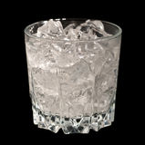 Glass with Ice. Glass with Transparent Liquid and Ice isolated on black Royalty Free Stock Photos