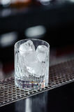 Glass with ice in a bar Stock Photo