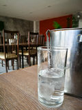 Glass and ice bucket. On wooden floor stock photography