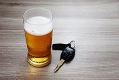 Glass of ice cold beer and car keys./Dont Drink and Drive./Drink Royalty Free Stock Photography